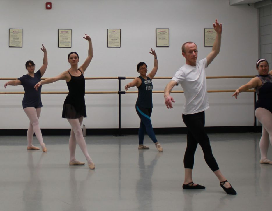 Adults in ballet class